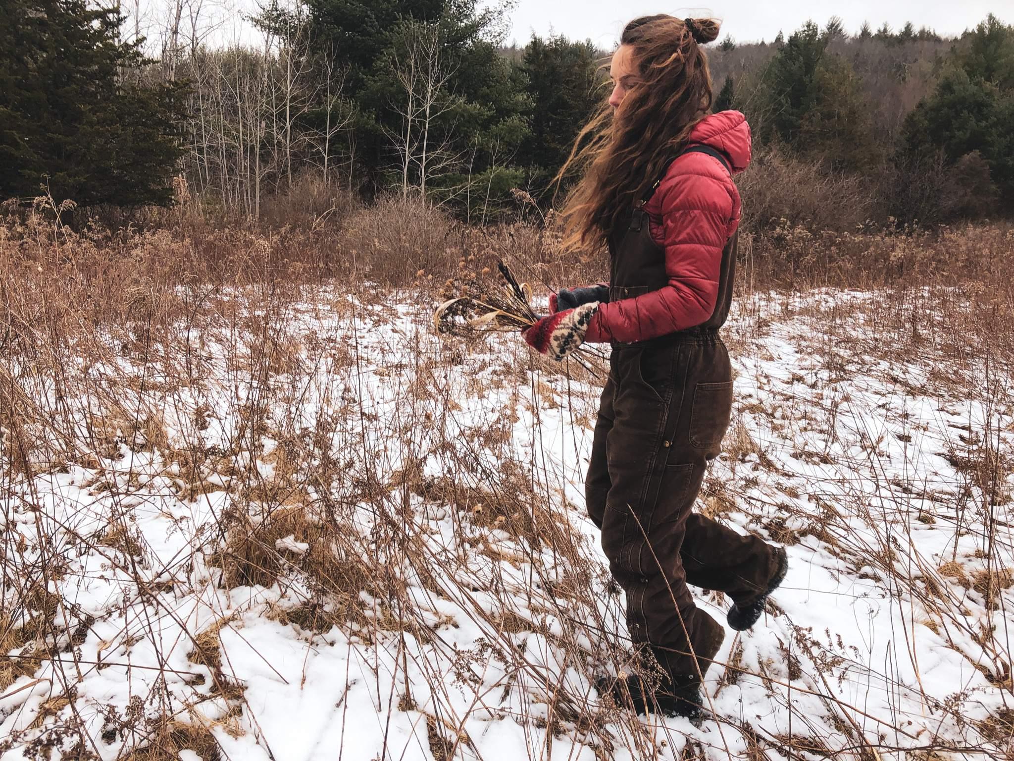 Woman walking in snowy pasture