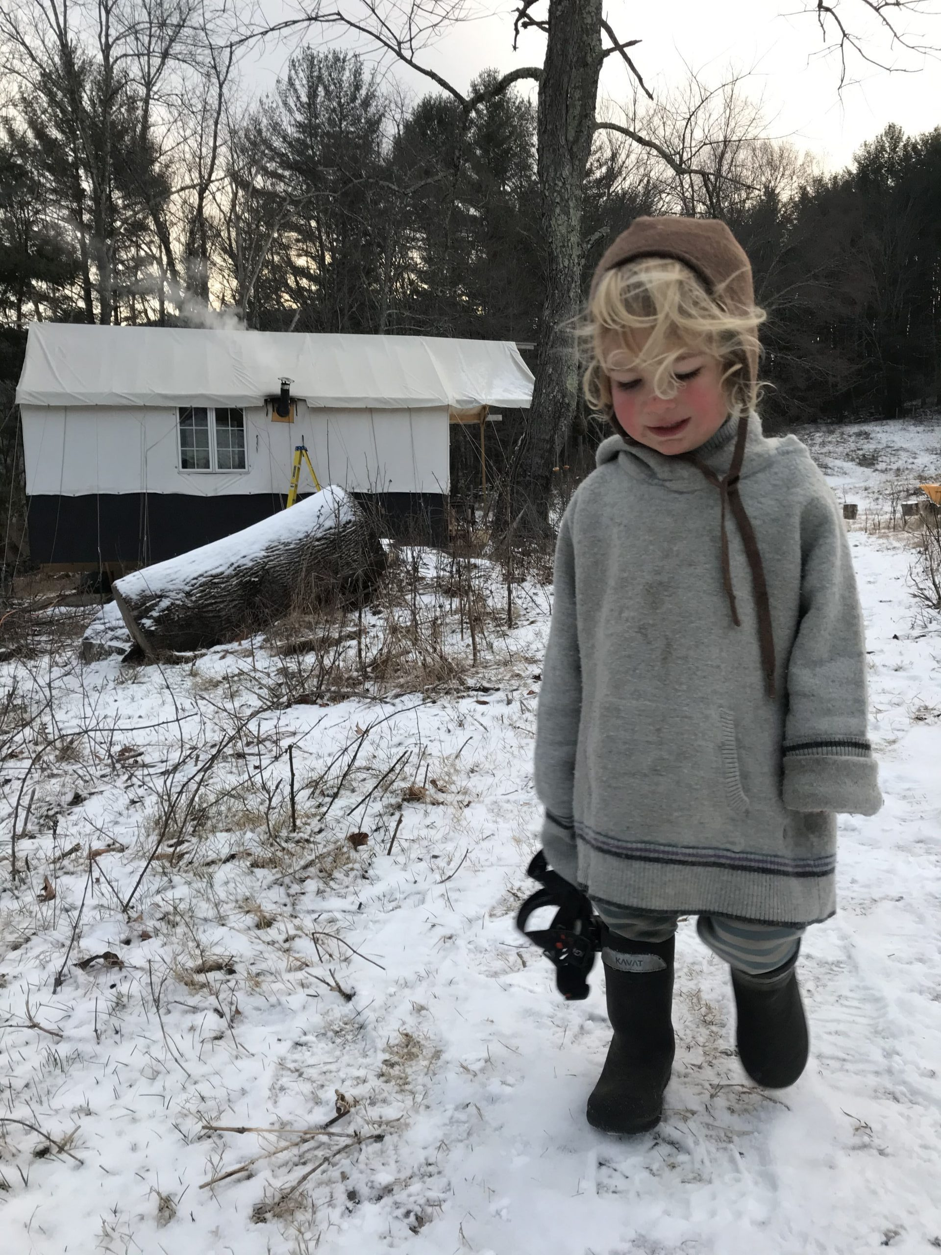 Little boy wearing warm wool clothes on cold winter day